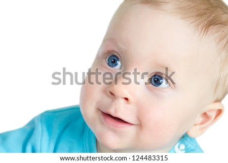 Portrait of 8-months old baby boy in blue t-shirt, on white background. - stock photo