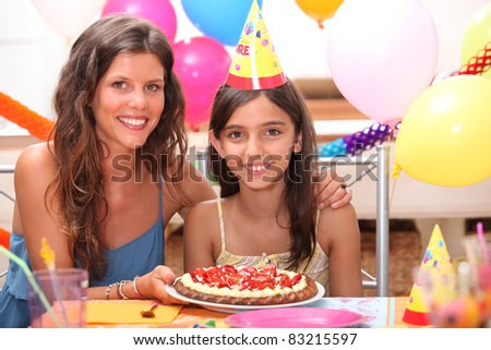 portrait of mother and daughter at birthday party
