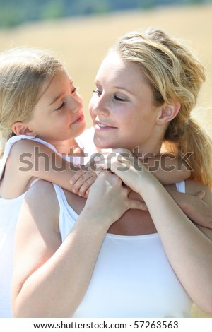 portrait of mother and daughter in summer