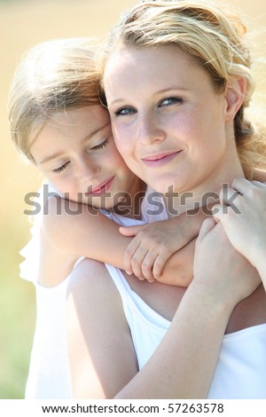 portrait of mother and daughter in summer - stock photo