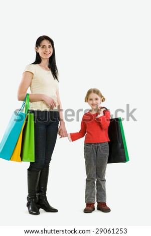 Portrait of mother and daughter with paperbags after shopping