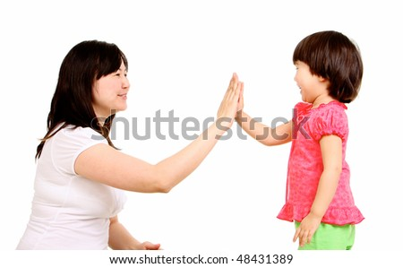 Portrait of mother and small daughter touching their palm - stock photo