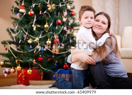 Portrait of mother and son at home on Christmas time