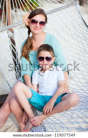 Portrait of mother and son relaxing in hammock