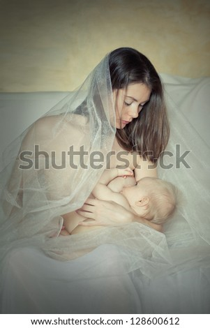 portrait of mother breast-feeds the baby