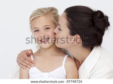 Portrait Of Mother Kissing Her Daughter In Bathroom Stock