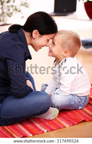 Portrait of Mother with happy son at home