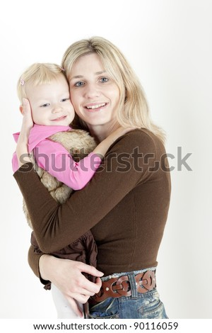 portrait of mother with her little daughter