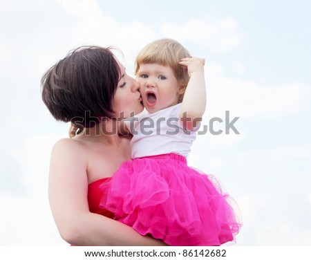 Portrait of mother with her little daughter outdoor