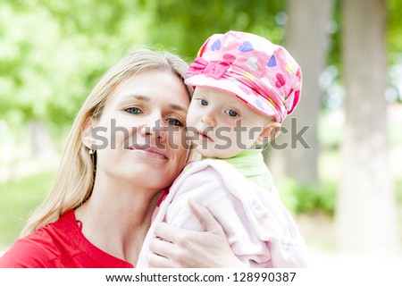 portrait of mother with little daughter