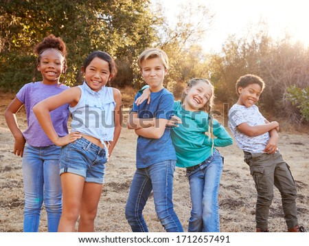 Portrait Of Multi-Cultural Children Posing And Hanging Out With Friends In Countryside Together Stock photo ©
