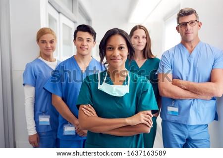 Portrait Of Multi-Cultural Medical Team Standing In Hospital Corridor