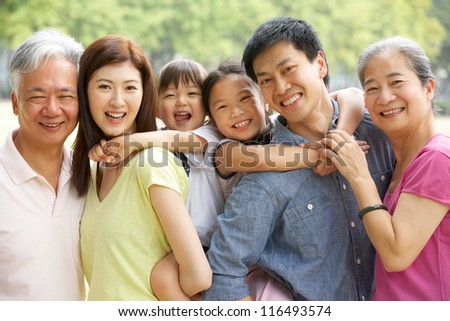 Portrait Of Multi-Generation Chinese Family Relaxing In Park Together - Shutterstock ID 116493574