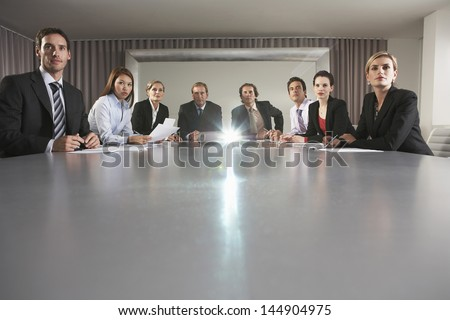 Portrait of multiethnic business people watching presentation in conference room