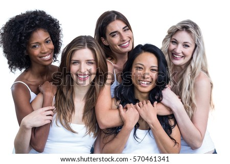 Portrait of multiethnic women embracing each other on white background