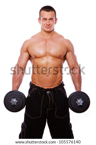 Portrait of muscle man doing exercises with dumbbells