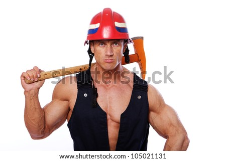 Portrait of muscle man in fireman uniform with hummer