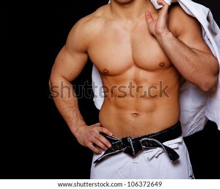 Portrait of muscle man in kimono
