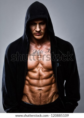 Portrait of muscle man posing in studio