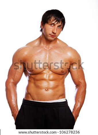 Portrait of muscle man posing in studion on white background