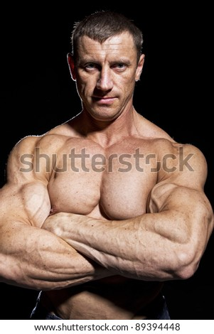 Portrait of muscular bodybuilder, isolated on black