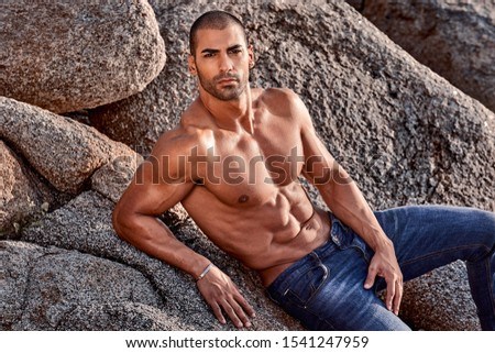 Portrait of muscular man over the reef
