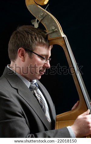 Portrait of musician leaning against upright bass