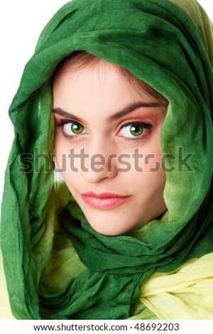 Portrait of mysterious beautiful Caucasian Hispanic Latina woman face with green penetrating eyes and green fashion scarf wrapped around head, isolated.