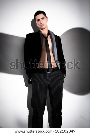 Portrait of naked man wearing suit