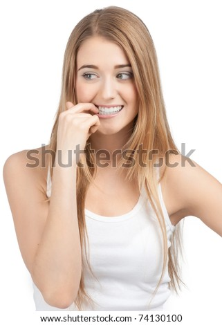 Portrait of nervous pretty young woman biting her nails. Isolated on white background.