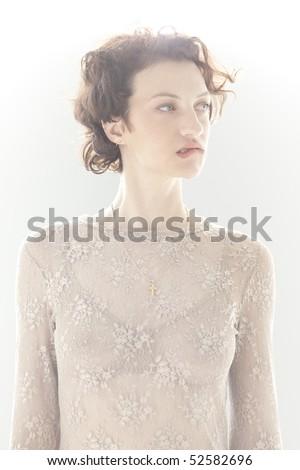 Portrait of nervous woman biting lip