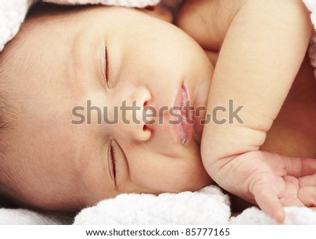 portrait of newborn baby sleeping on a blanket