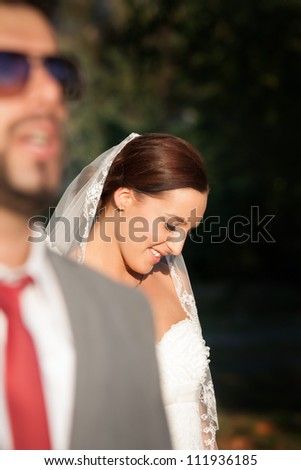 Portrait of newly married couple walking together - stock photo
