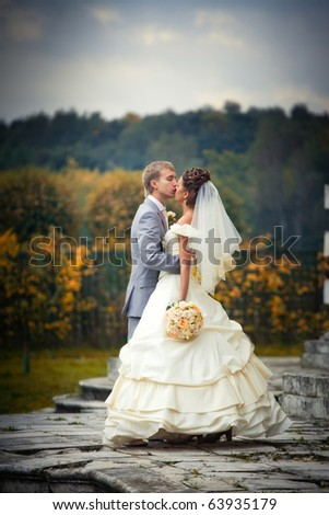 Portrait of newlyweds in autumn park in moscow estate