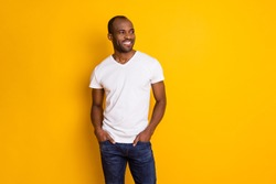 Portrait of nice attractive candid afro american guy look copyspace enjoy spring free time weekend put hands pocket wear modern outfit isolated over bright color background