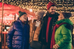Portrait of nice attractive cheerful family enjoying embracing having fun spending, free spare time street city urban market newyear celebratory festival christmastime outside outdoor