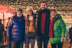Portrait of nice attractive cheerful family meeting embracing traveling, spending time visiting festal street market newyear gathering tradition wintertime outside outdoor