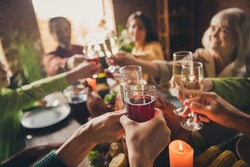 Portrait of nice attractive family sitting around served table clinking glasses celebratory good mood every year cozy festive at modern loft industrial wooden interior house apartment