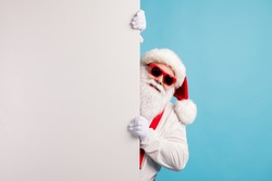 Portrait of nice attractive funky cheerful white-haired Santa holding copy space placard announcement promotion isolated over bright vivid shine vibrant blue color background