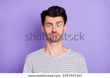 Portrait of nice attractive funny crazy brunette guy grimacing isolated over bright violet purple color background Сток-фото ©