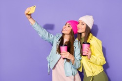 Portrait of nice attractive lovely pretty cheerful cheery girls drinking latte taking making selfie travel traveler isolated on bright vivid shine vibrant violet lilac purple color background