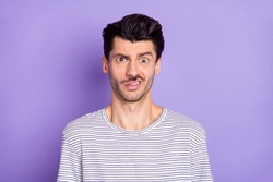 Portrait of nice attractive puzzled guy grimacing dont know clueless isolated over bright violet purple color background