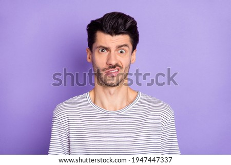 Portrait of nice attractive puzzled guy grimacing dont know clueless isolated over bright violet purple color background Сток-фото ©