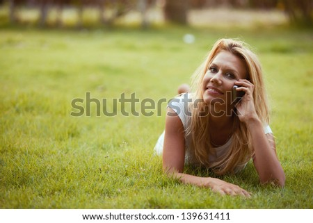 portrait of nice beautiful woman calling by phone outdoors