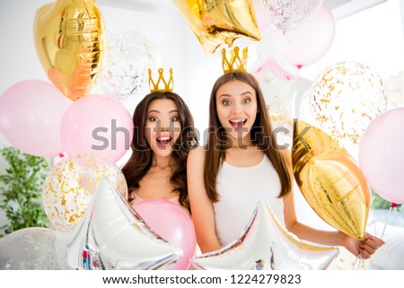 Portrait of nice brunette wondered astonished stunned lovely sweet girlish cute stylish charming cheerful girls holding baloons in hands opened mouth indoors in white light interior room