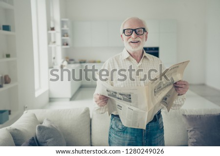 4f3a09068e28 Portrait of nice cheerful positive cheery stylish old man wearing checked  shirt holding in hand news