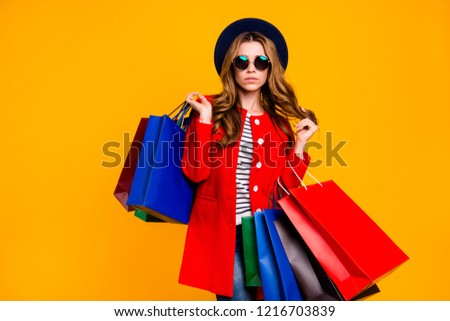 Portrait of nice cool confident cute dreamy elegant chic classy attractive curly-haired lady in round eyeglasses eyewear holding bags playing curls wear outfit isolated over yellow background #1216703839