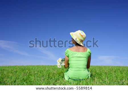 portrait of nice cute woman with flowers in summer environment