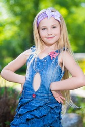 Portrait of nice little girl posing outdoors