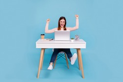Portrait of nice lovely attractive cheerful cheery glad girl grant winner win good job done breakthrough at work place station isolated over bright vivid shine blue green background